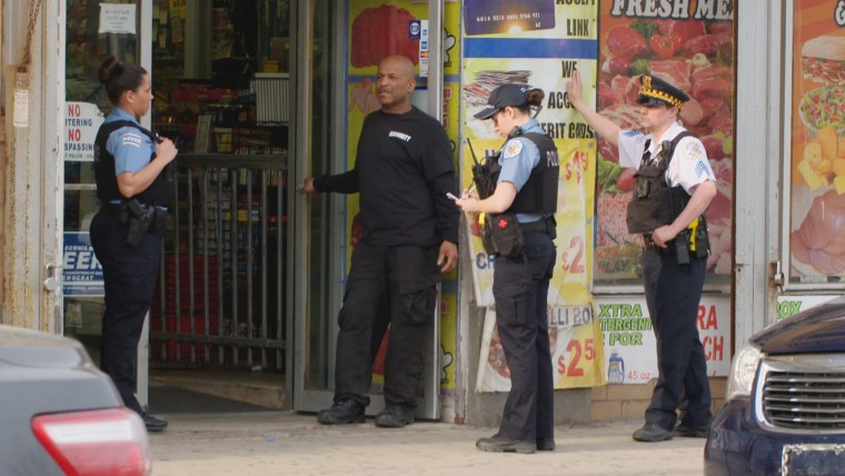 Image: Police respond to a scene at a bodega in Chicago