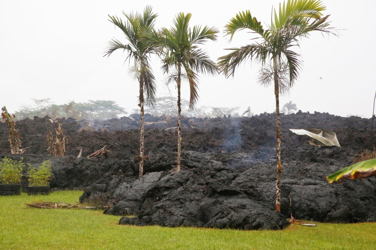 Image: Lava cools in a resident's yard in the Leilani Estates subdivision during ongoing eruptions of the Kilauea Volcano