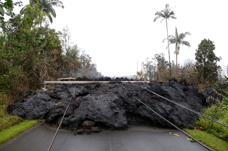 Image: Lava and downed power lines block a road in the Leilani Estates subdivision during ongoing eruptions of the Kilauea Volcano
