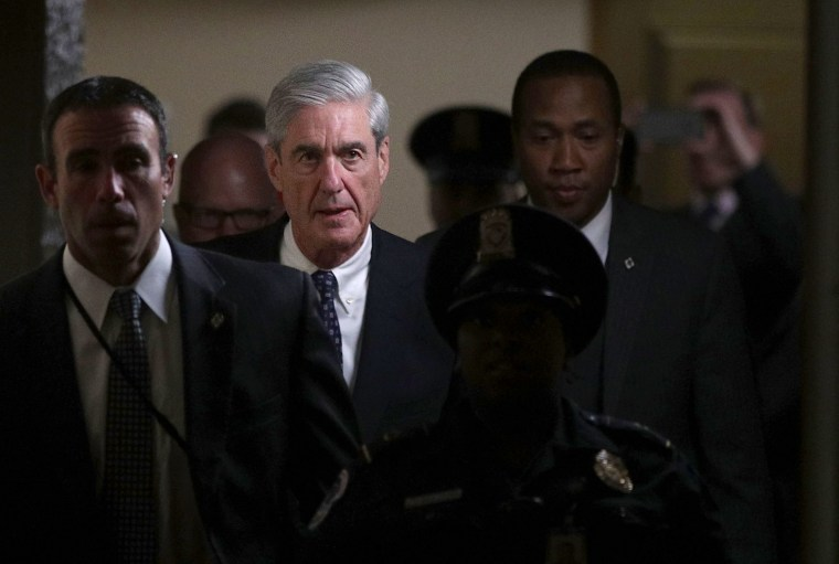 Image: Special counsel Robert Mueller leaves after a closed meeting with members of the Senate Judiciary Committee on June 21, 2017 at the Capitol in Washington, DC.