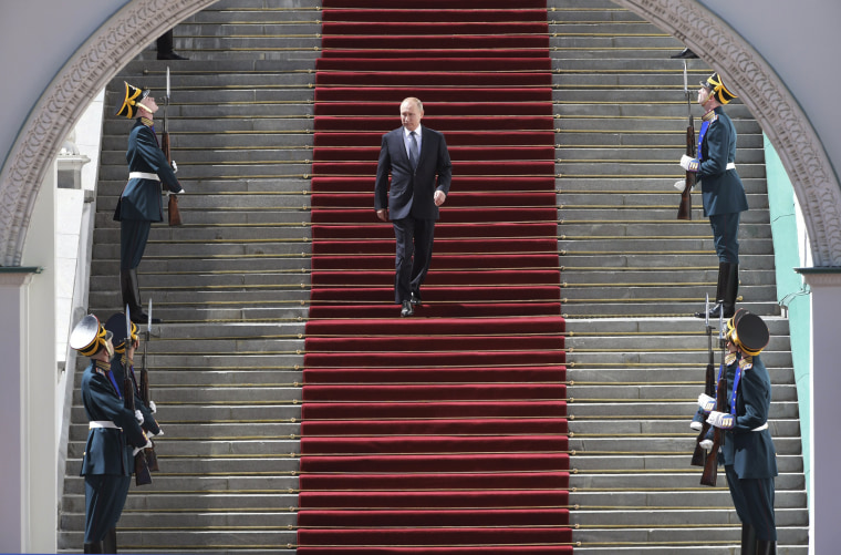 Image: Vladimir Putin leaves following his inauguration ceremony for his fourth term as Russia's president