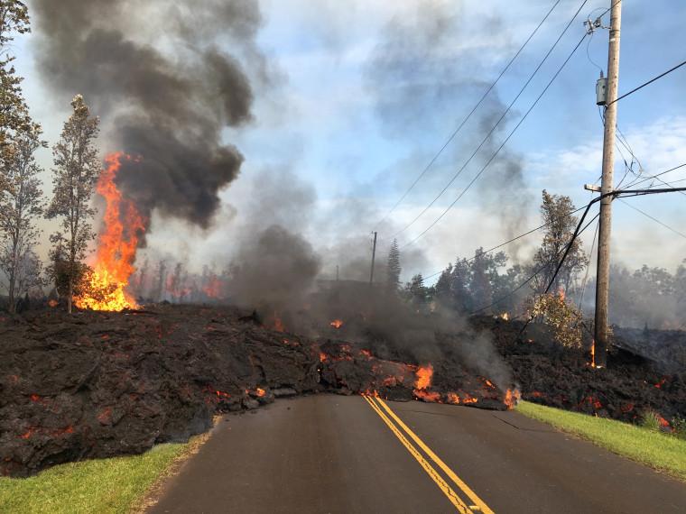 Image: Lava advances along a street near a fissure in Leilani Estates, on Kilauea Volcano's lower East Rift Zone, Hawaii