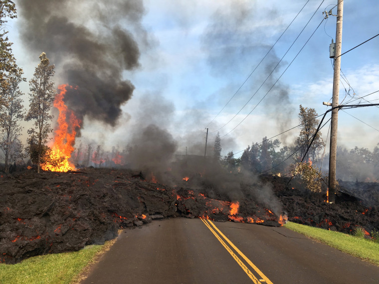 Image: Lava advances along a street near a fissure in Leilani Estates, on Kilauea Volcano's lower East Rift Zone, Hawaii