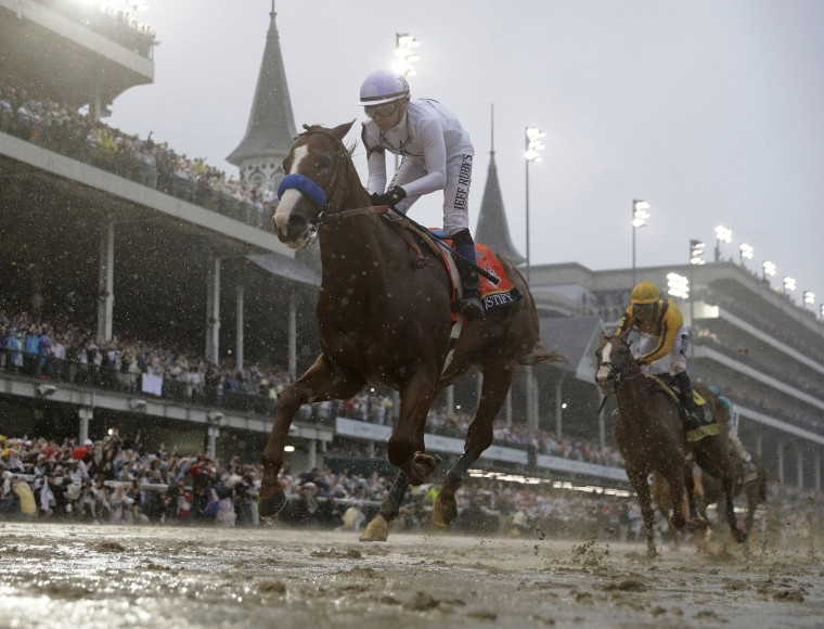 Image: Mike Smith rides Justify to victory during the 144th running of the Kentucky Derby