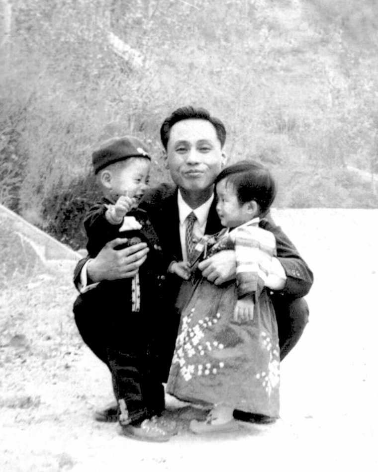 Image:Hwang Won, pictured with his son and niece, was abducted in December 1969.