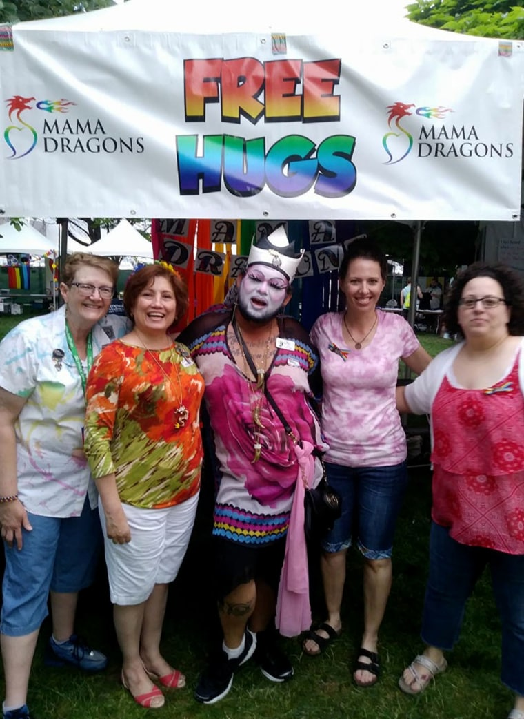 Image: Mama Dragons host a hugging booth during the 2017 Salt Lake City Pride festival.
