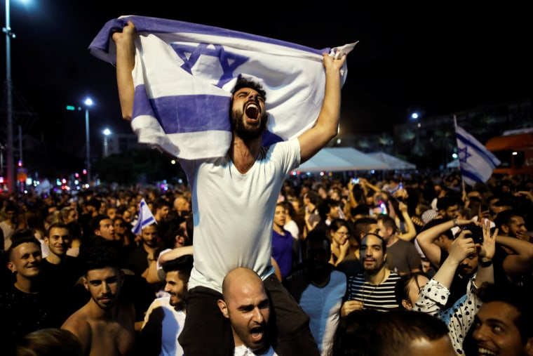 "Image: People celebrate the winning of the Eurovision Song Contest 2018 by Israel's Netta Barzilai with her song ""Toy"" , Rabin square in Tel Aviv Israel"