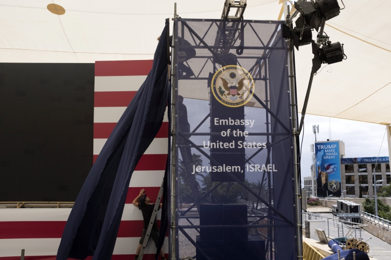 Image: Israeli workers prepare the ceremony stage inside the U.S. consulate that will act as the new embassy on May 13, 2018 in Jerusalem, Israel.