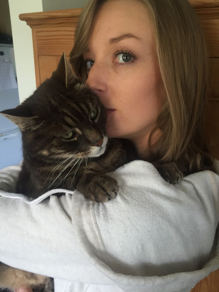 Woman's ex-boyfriend replaced with family cat in photos