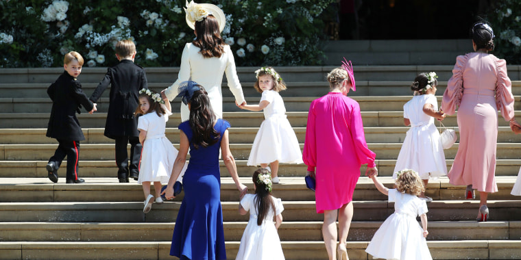 Prince George of Cambridge,  Jasper Dyer, Princess Charlotte of Cambridge, Catherine, Duchess of Cambridge, Jessica Mulroney, Ivy Mulroney, Florence van Cutsem, Zoe Warren, Zalie Warren, Benita Litt, Remy Litt and Rylan Litt arrive at St George's Chapel at Windsor Castle for the wedding of Prince Harry and Meghan Markle in St George's Chapel at Windsor Castle on May 19, 2018 in Windsor, England.