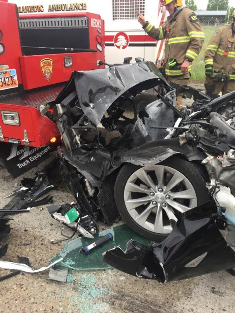 Image: A Tesla Model S is seen after it hit the back of a mechanic truck  in South Jordan,