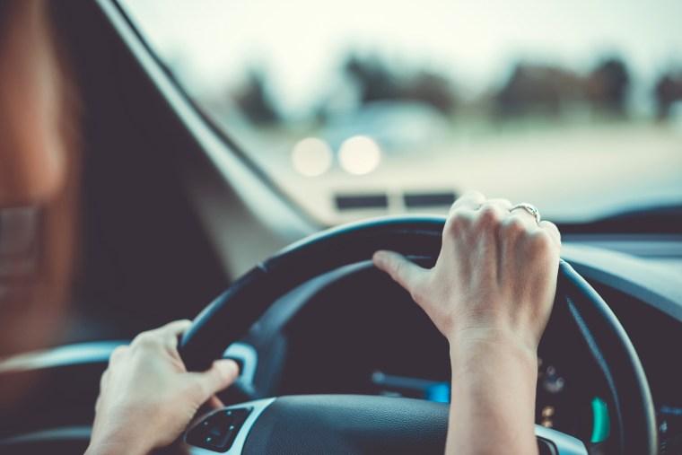 Image: Woman driving car or SUV