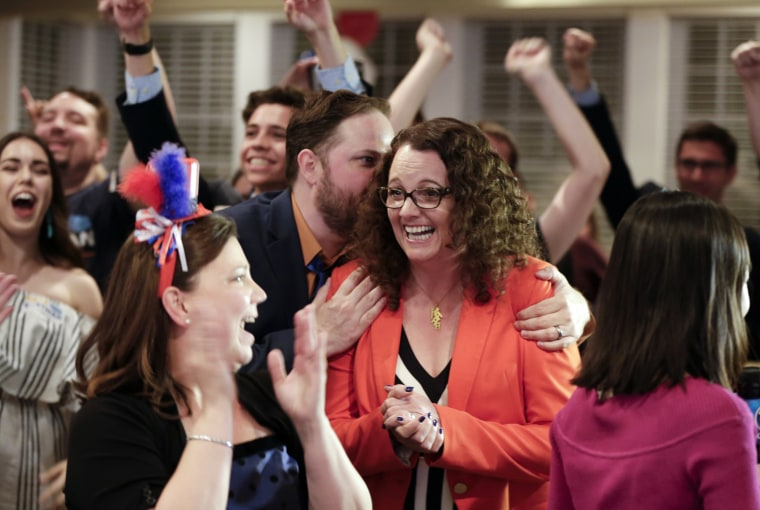 Image: Kara Eastman is hugged by her campaign manager