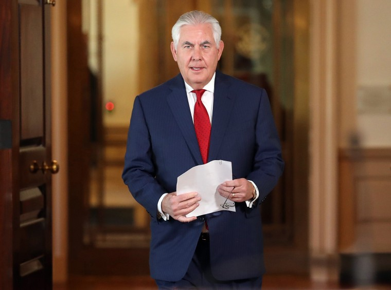 Image: Rex Tillerson walks to a podium before making a statement at the State Department