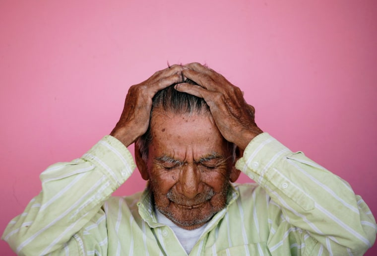 Image: Manuel Garcia, who says he is 121-years old, fixes his hair before posing for a photograph, outside his home in Ciudad Juarez