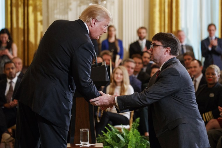 Trump shakes hands with acting Department of Veterans Affairs Secretary Robert Wilkie