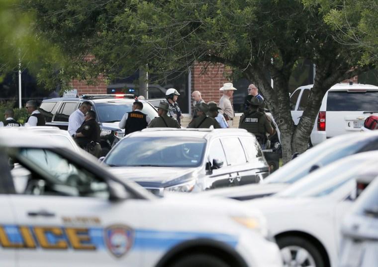 Emergency responders from multiple agencies work at the scene.