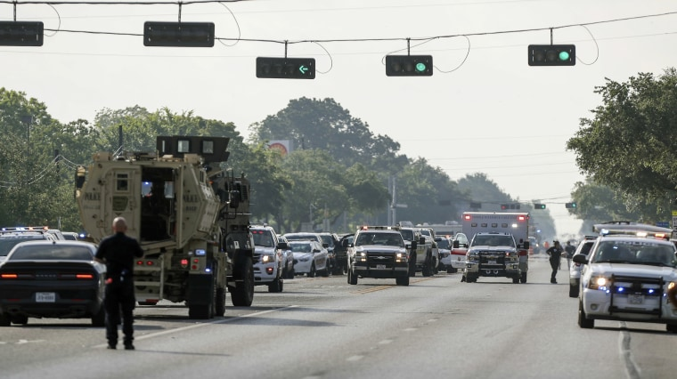 Emergency responder vehicles line the street in front of Santa Fe High School.