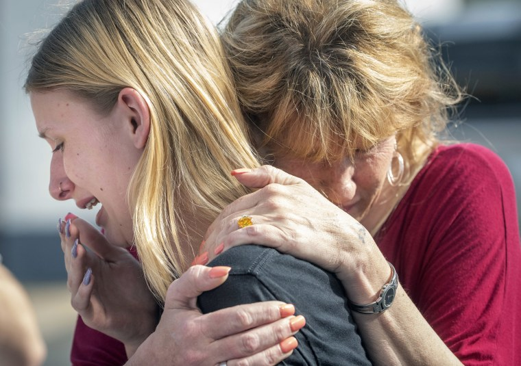 Santa Fe High School student Dakota Shrader is comforted by her mother Susan Davidson following a shooting at the school on May 18, 2018, in Santa Fe, Texas. Shrader said her friend was shot in the incident.