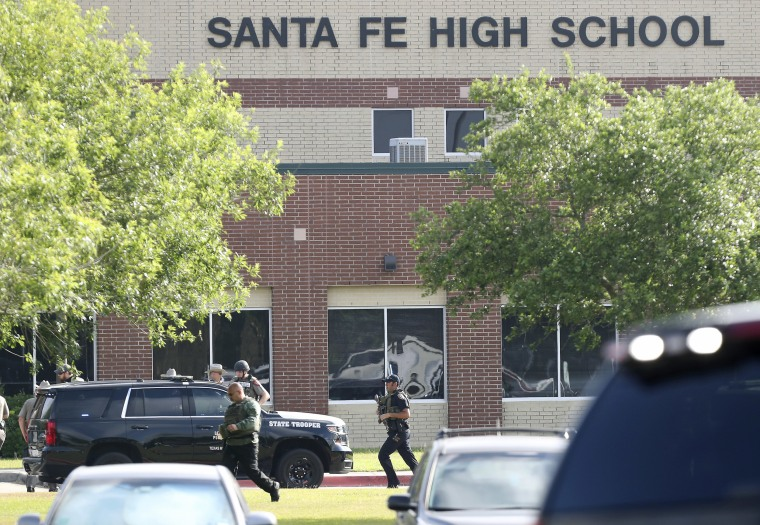 Law enforcement officers respond to Santa Fe High School after an active shooter was reported on campus.