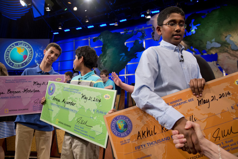 National Geographic Bee 2014 winners hold their awards