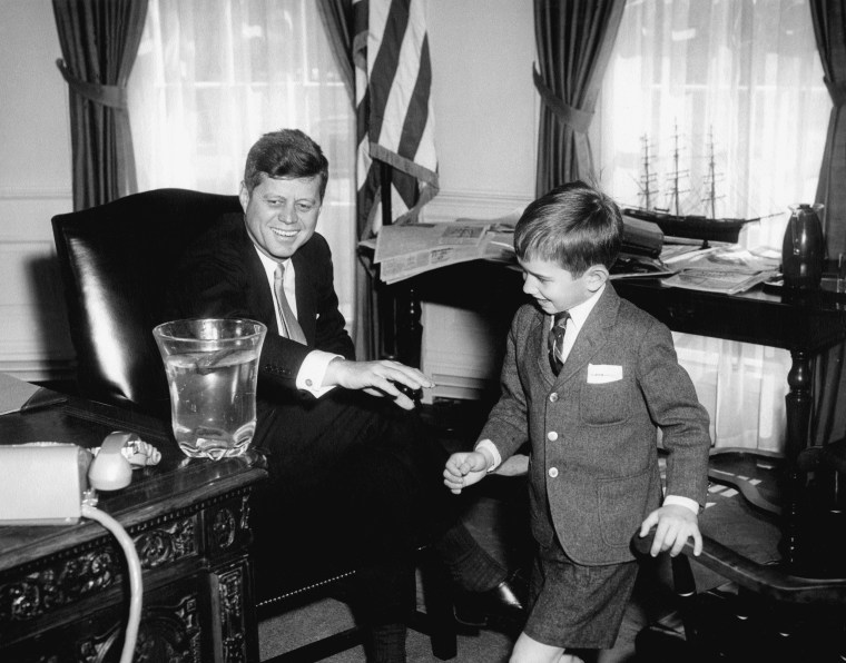 """Image: President John F. Kennedy, with his nephew, Robert F. Kennedy, Jr. during the """"dead salamander"""" visit on March 1961 in the Oval Office."""