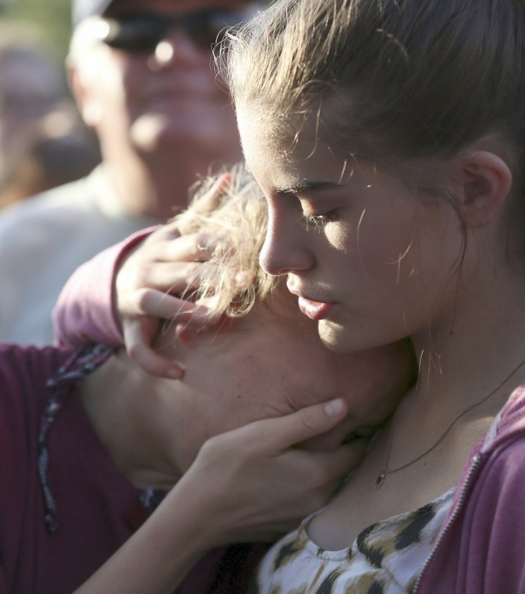 Image: Abigail Adams, right, comforts her friend Hannah Hershey, 13, during a vigil for the victims of the Santa Fe High School shooting, May 18, 2018, in Santa Fe, Texas.