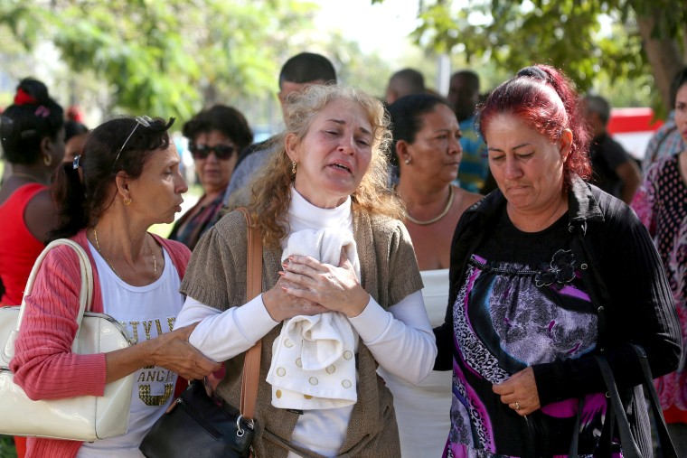 Image: Relatives of victims of the Boeing 737 plane that crashed after taking off from Havana's main airport yesterday, react as they leave the Legal Medical Institute in Havana