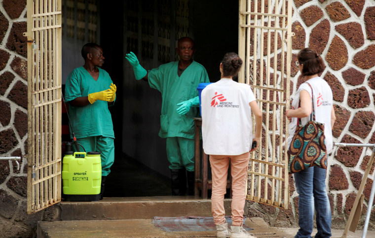 Image: Medecins Sans Frontieres (MSF) workers talk to a worker at an isolation facility, prepared to receive suspected Ebola cases, at the Mbandaka General Hospital, in Mbandaka, Democratic Republic of Congo on May 20, 2018.