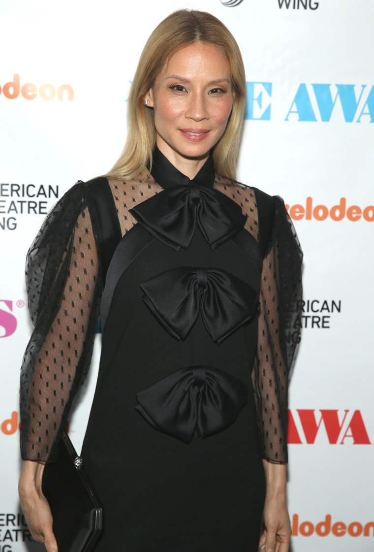 Lucy Liu has blond hair at the Obie Awards