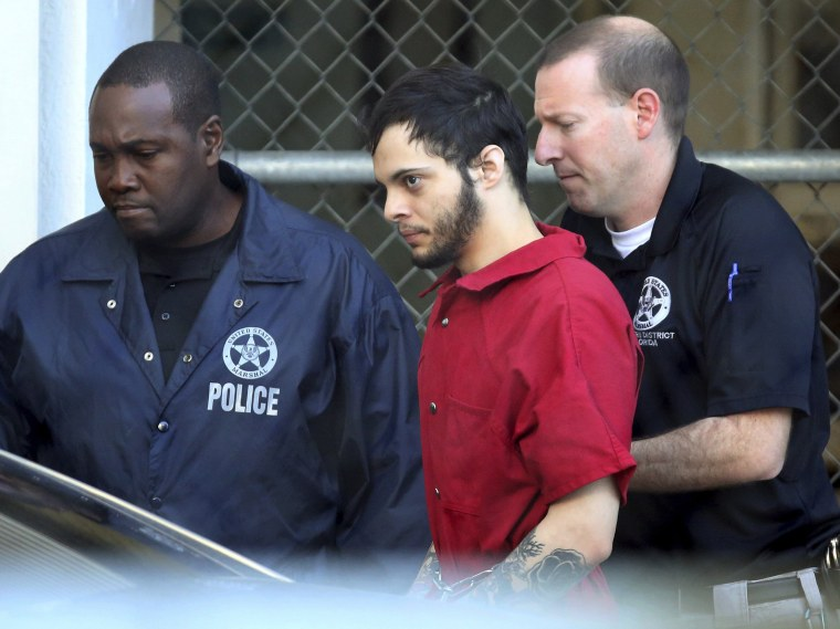 Image: Esteban Santiago, center, leaves the Broward County jail