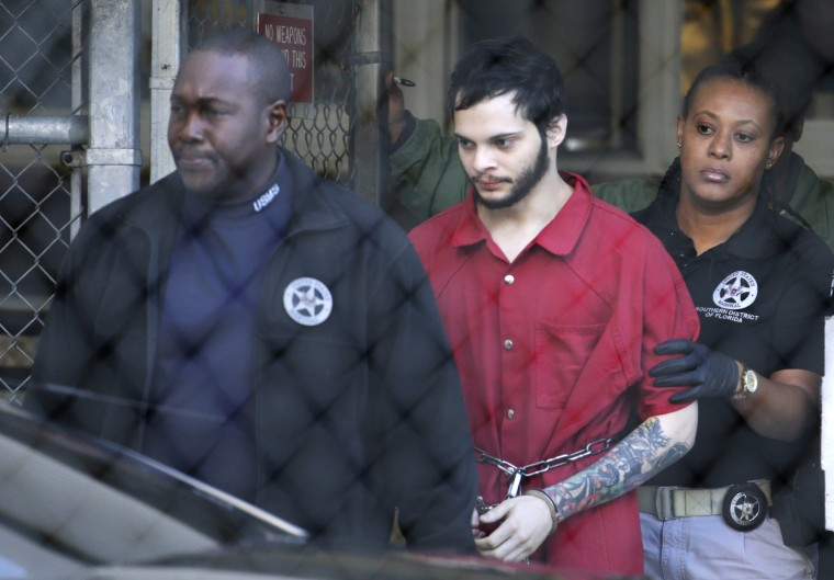 Image: Esteban Santiago is led from the Broward County jail