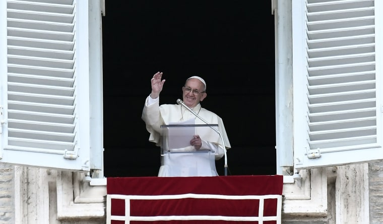 Image: Pope Francis waves as he addresses the faithful gathered in Saint Peter Square