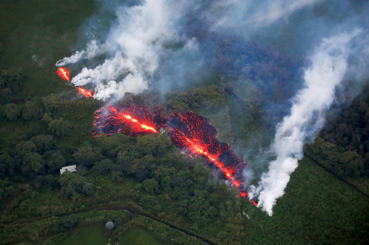 Image: Lava erupts from a fissure east of the Leilani Estates subdivision during ongoing eruption