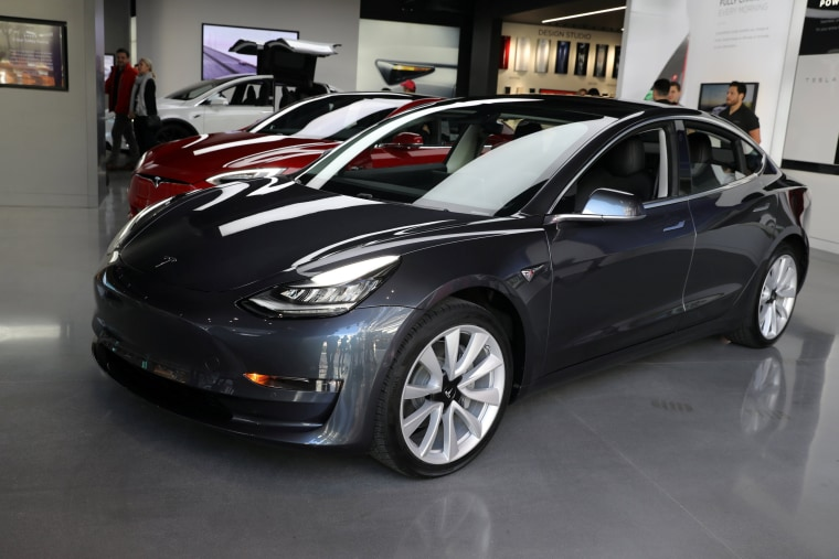 Image: FILE PHOTO:    A Tesla Model 3 is seen in a showroom in Los Angeles