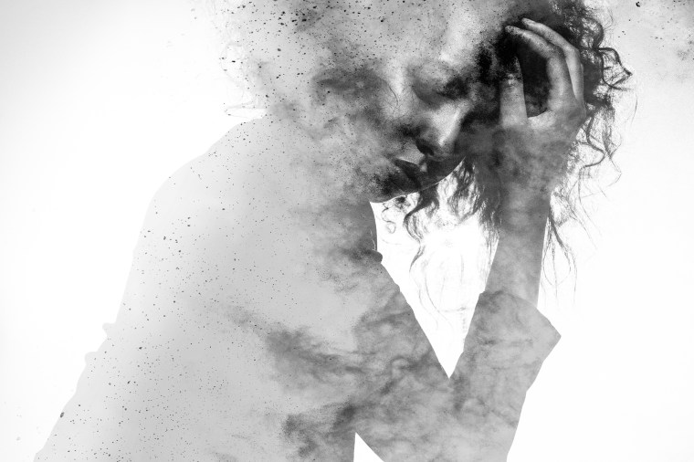 Image: Unhappy woman's form double exposed with paint splatter effect
