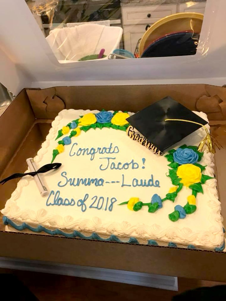 Image: The cake from Publix with dashes for the phrase Summa Cum Laude.
