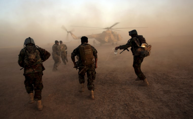 Image: Afghan army commandos train at the Shorab military camp in Helmand province