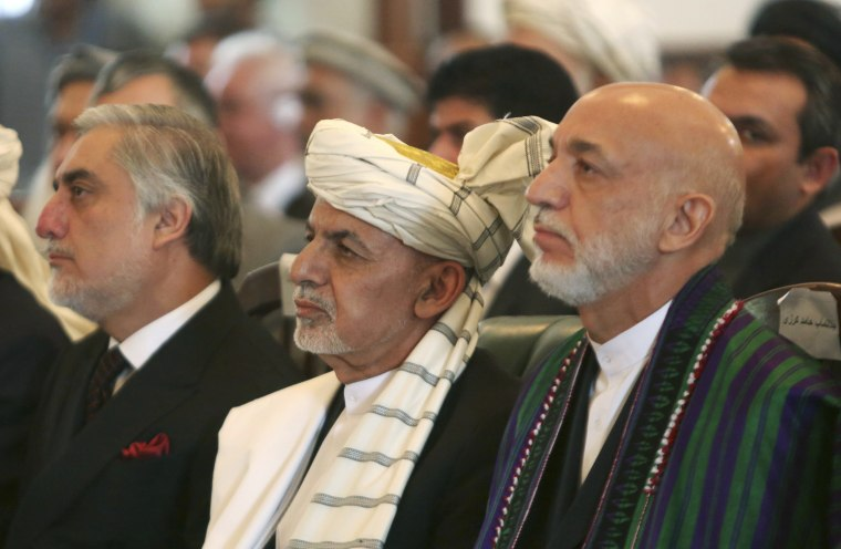 Image: Afghan President Ashraf Ghani, center, former President Hamid Karzai, right, and Chief Executive Abdullah Abdullah