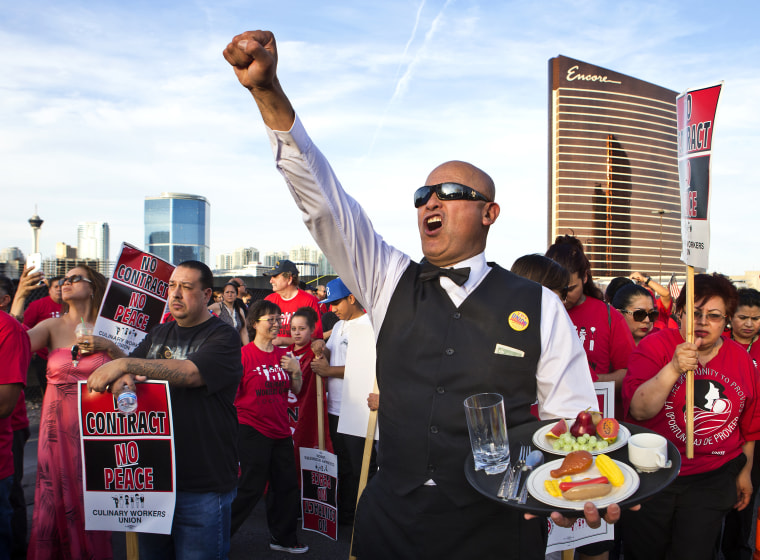 Culinary Union member Jose Rivera joins Trump International Hotel Las Vegas workers and other union supporters after marching down Las Vegas Blvd. on April 20, 2016.
