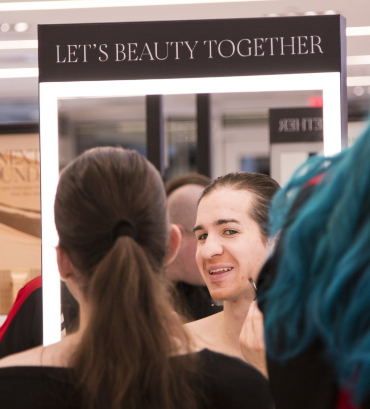 "A participant applies makeup in one of Sephora's ""Bold Beauty for the Transgender Community"" classes."
