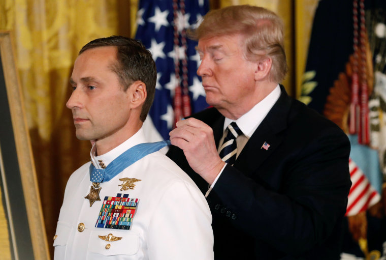 Image: President Donald Trump awards the Medal of Honor to Retired Navy Master Chief Special Warfare Operator (Sea, Air, and Land) Britt Slabinski