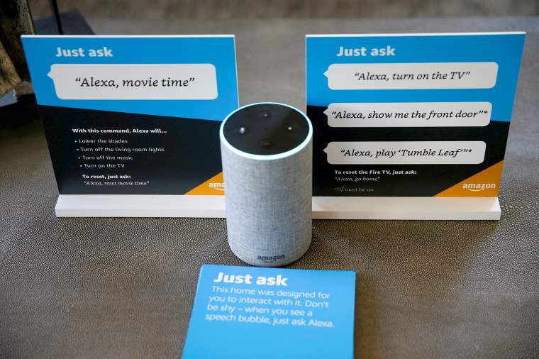 Image: Prompts on how to use Amazon's Alexa personal assistant are seen alongside an Amazon Echo in an Amazon ?EUR~experience center?EUR(TM)  in Vallejo