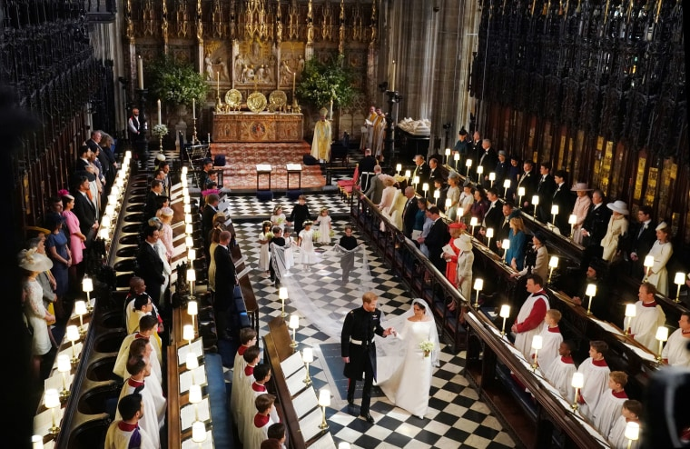 Image: Prince Harry, Duke of Sussex and the Duchess of Sussex leave following their wedding ceremony