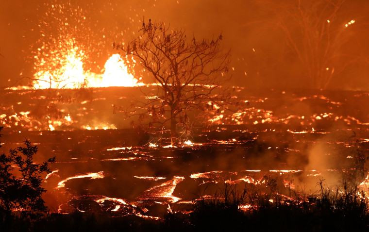 Image: Lava erupts and flows from a Kilauea volcano fissure in Kapoho