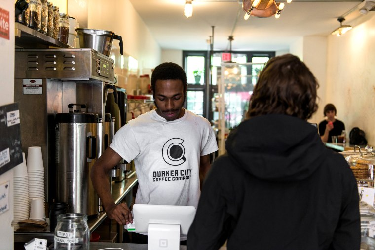 Image: Jayson McCoy, a barista at Quaker City Coffee, tends to a customer in Philadelphia on May 22, 2018.