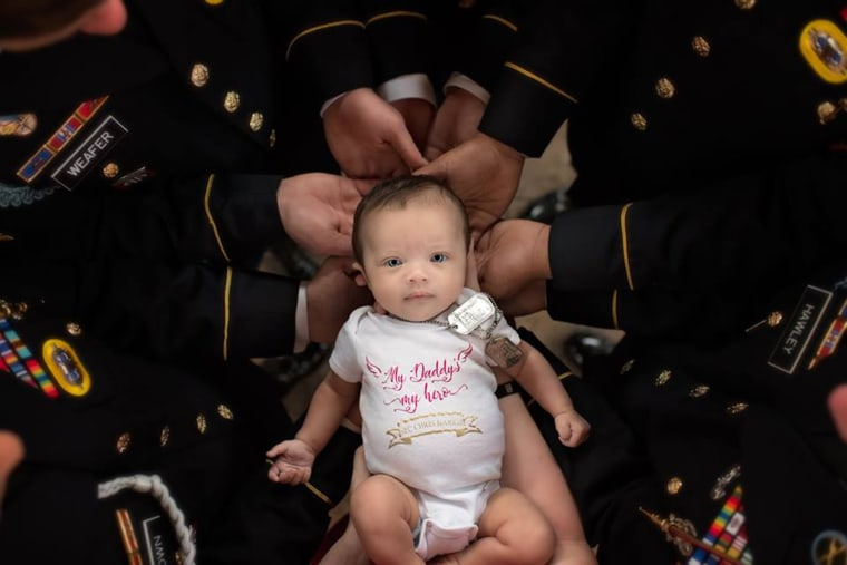 Newborn daughter of fallen soldier does photo shoot with army unit