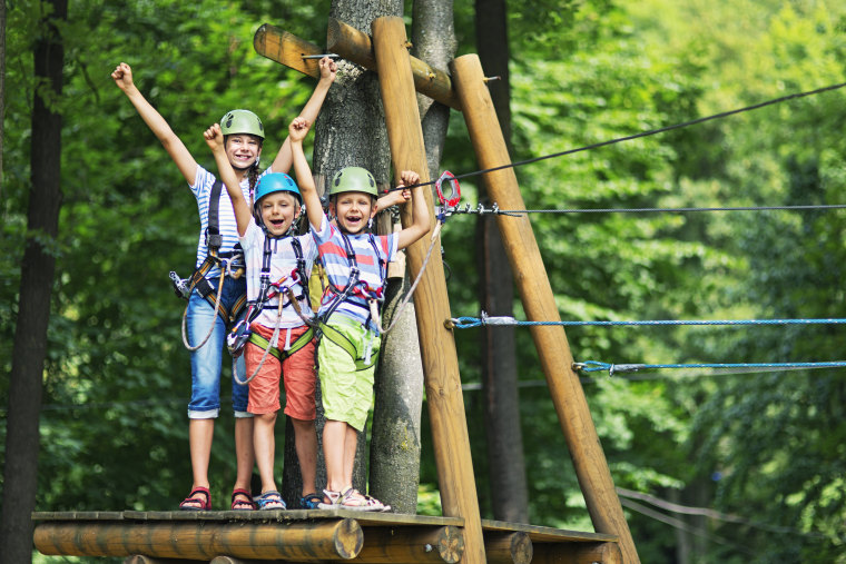 Kids having fun in ropes course adventure park