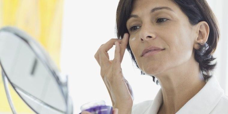 Image: Woman applying eye cream