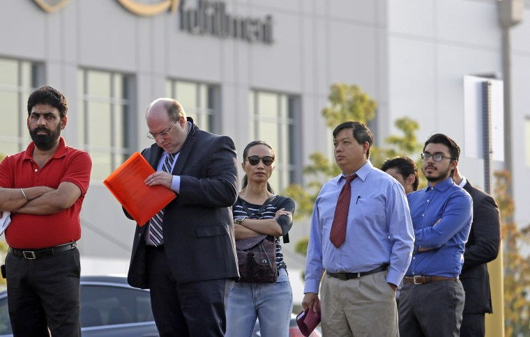 Applicants wait in line to enter a job fair on Aug. 2 at an Amazon fulfillment center, in Kent, Washington.